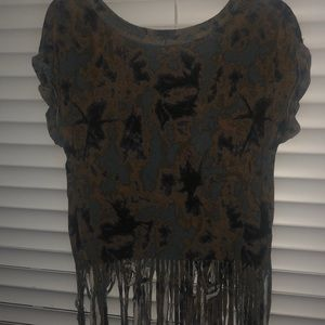 A tie-dye shirt with cuts at the bottom